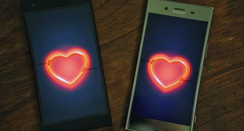 Two phones with hearts for online dating success
